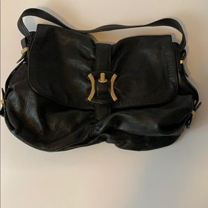 Black leather B. Makowsky purse.